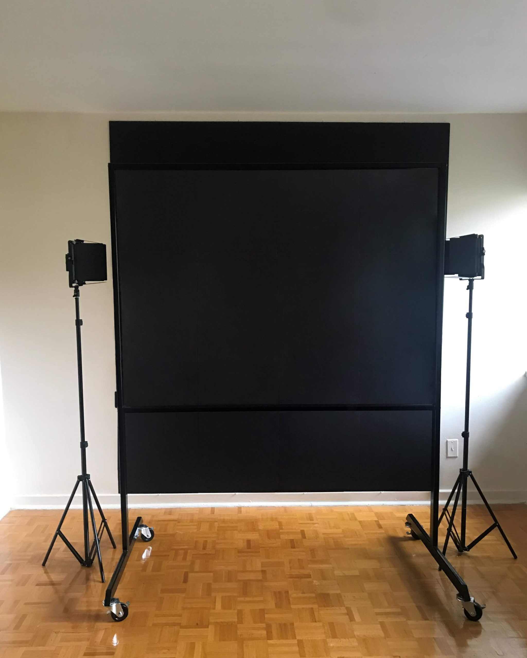 Lightboard studio package large showing lightboard classic product featured in front a black backdrop and two studio lights