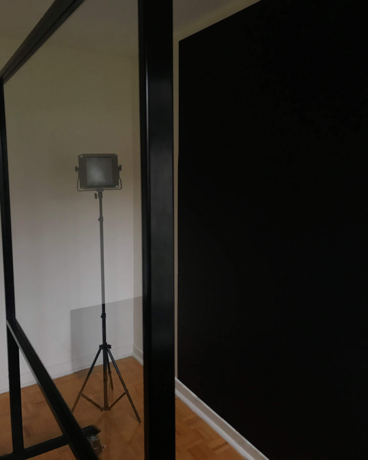 Studio package side view showing lightboard, lights and a black backdrop
